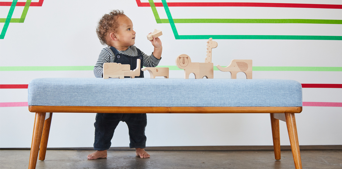 baby playing with wooden animal blocks