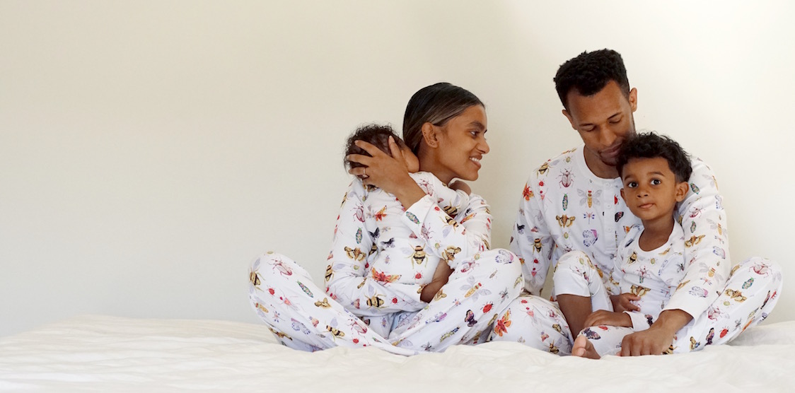 A happy family wearing matching Hart + Land Pima Cotton Pajamas