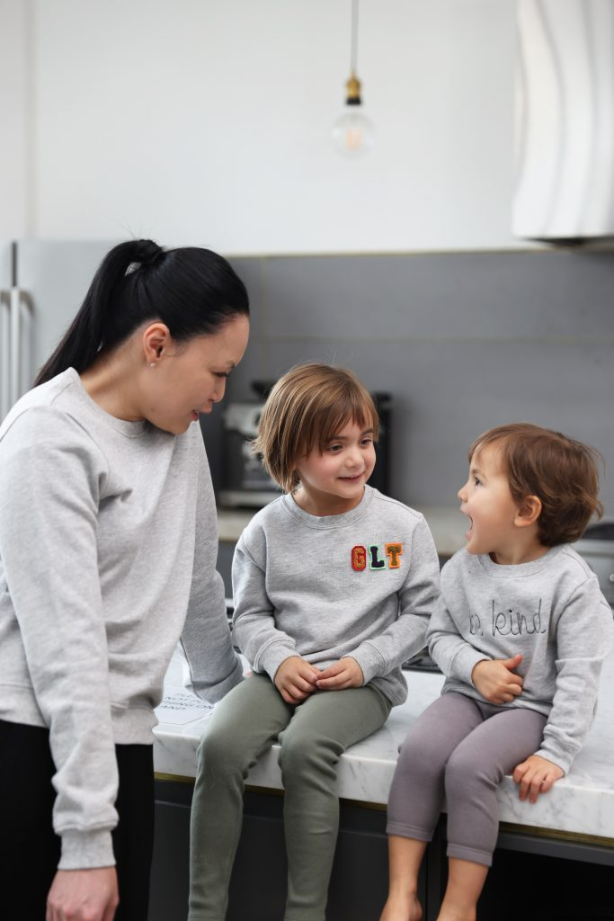 A mother and her kids wearing HART + LAND personalized organic cotton sweatshirts