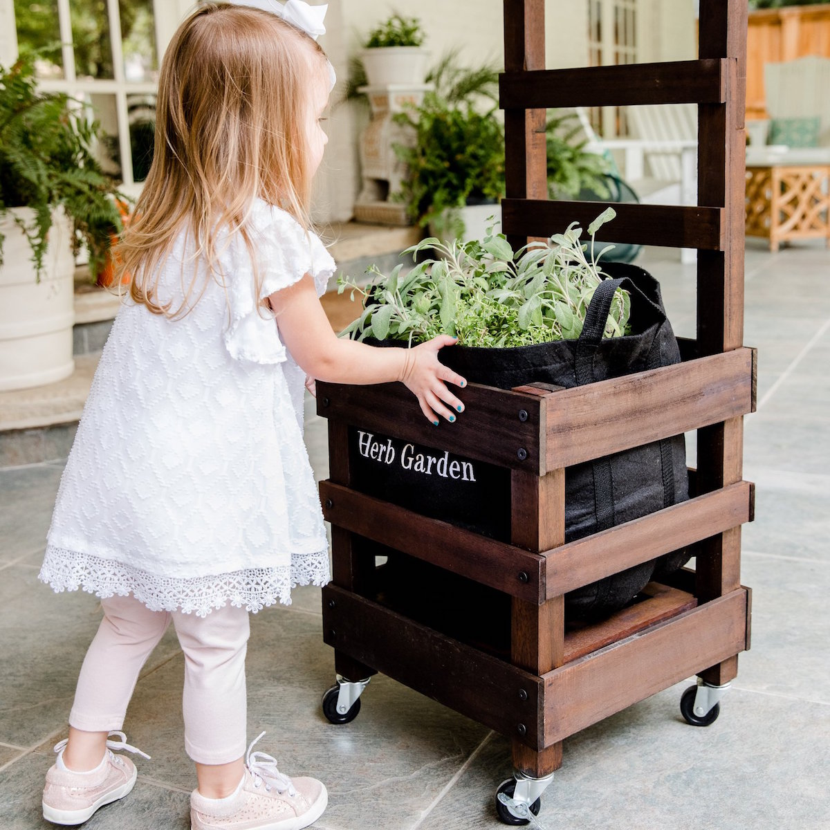 Little girl playing with a Gardenuity garden