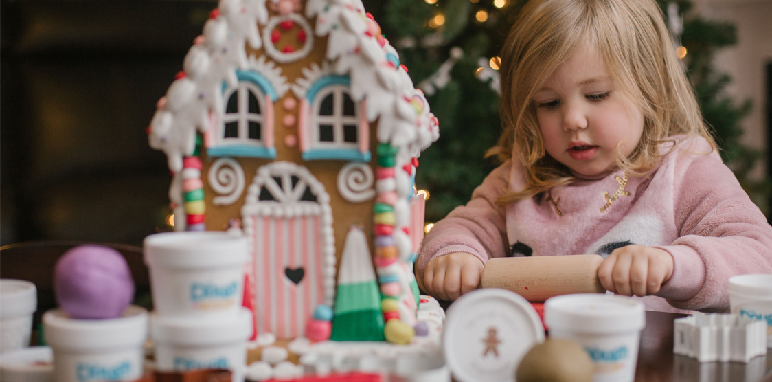 little girl making christmas crafts with play dough