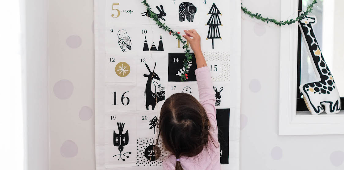 A child playing with the Wee Gallery Advent Calendar leading up to Christmas