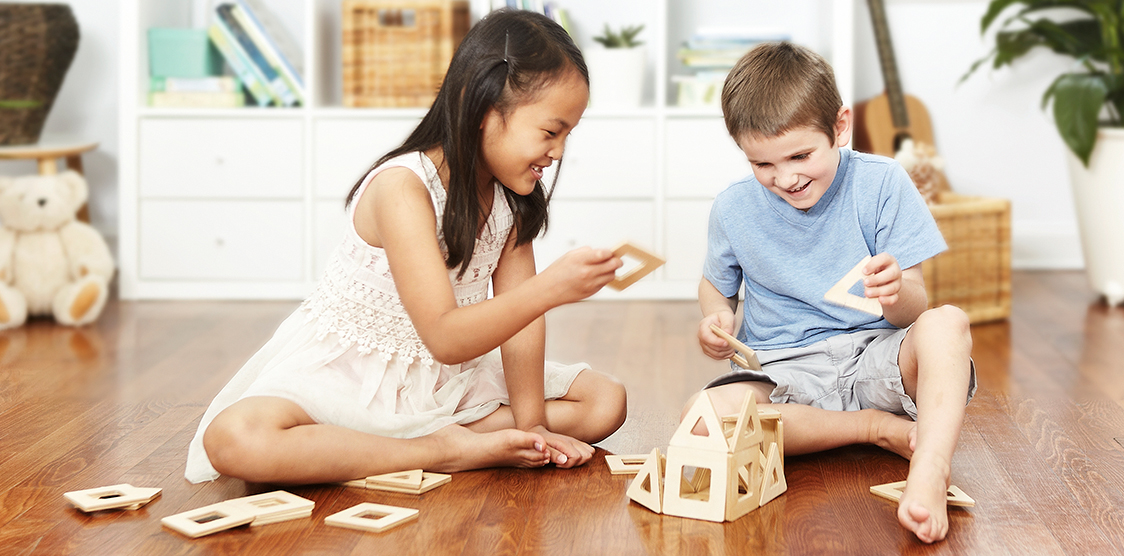 Kids playing with wooden earthtiles