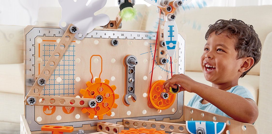 A child playing with the Hape Deluxe Scientific Workbench