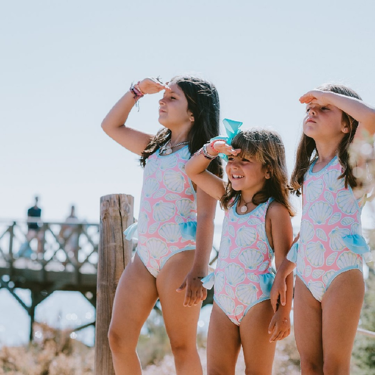 3 children at the beach wearing Sal & Pimenta swimwear
