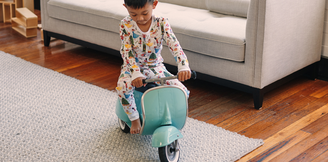 Boy riding kids toy scooter