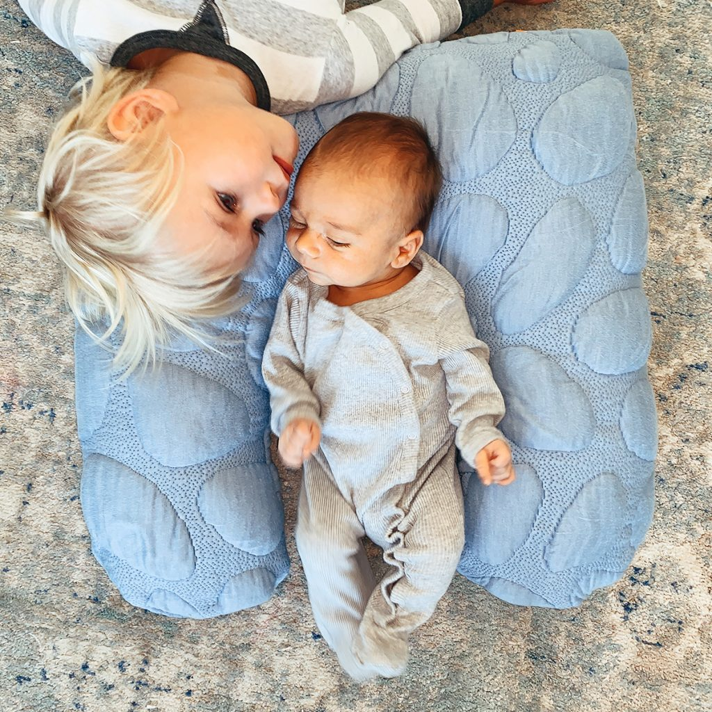 Lifestyle image of mom and baby with Nook Niche Feeding Pillow in Sky