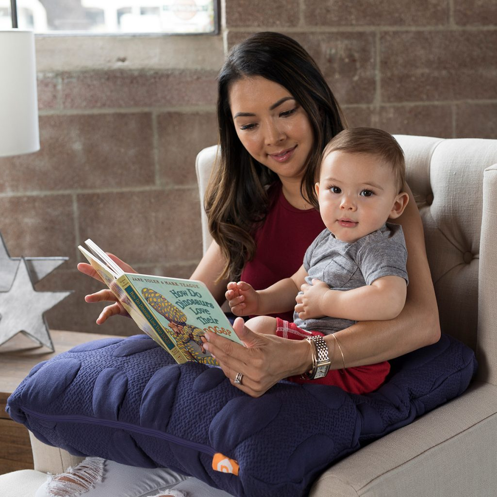 Lifestyle image of mom and baby with Nook Niche Feeding Pillow in Pacific