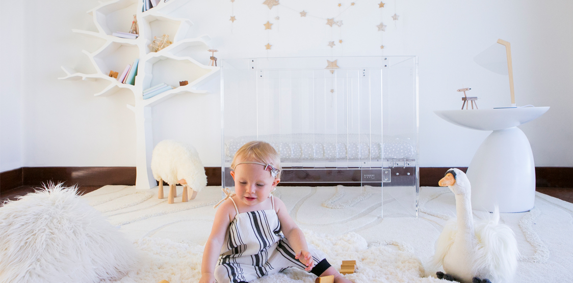 Toddler playing in a minimalist nursery