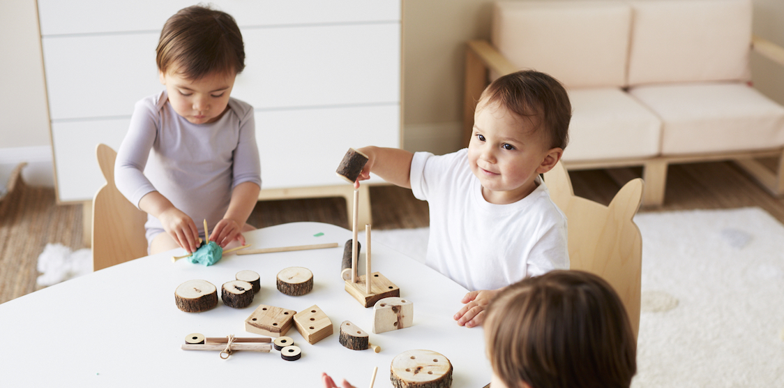 Three kids playing with the Let Them Play Starter Set