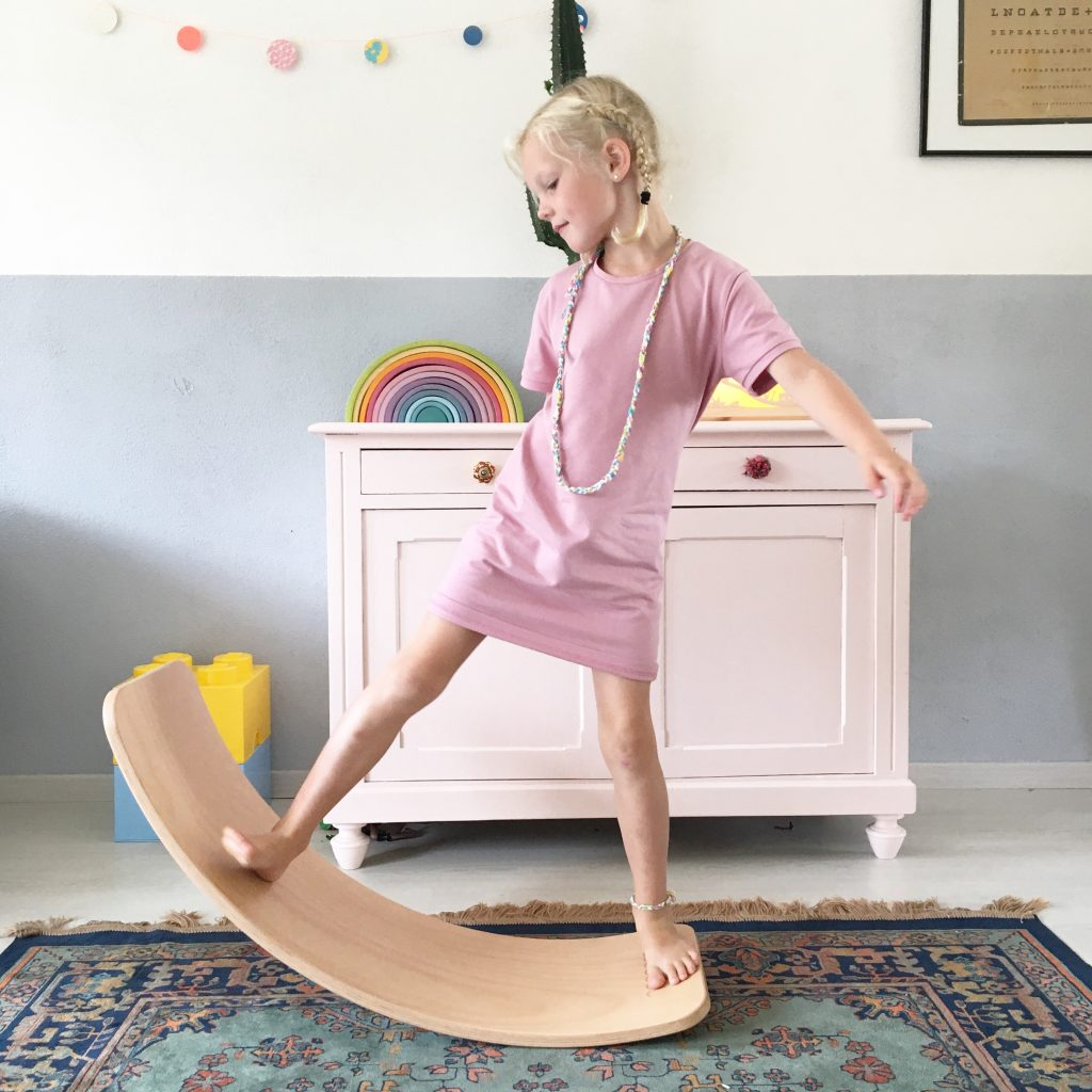 Girl balancing on a wobbel board