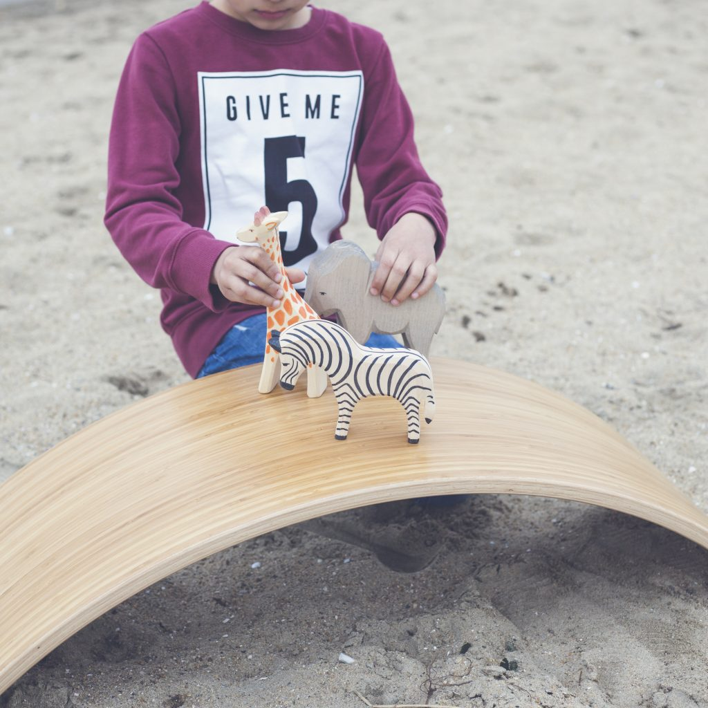 Kid playing on a wobbel board