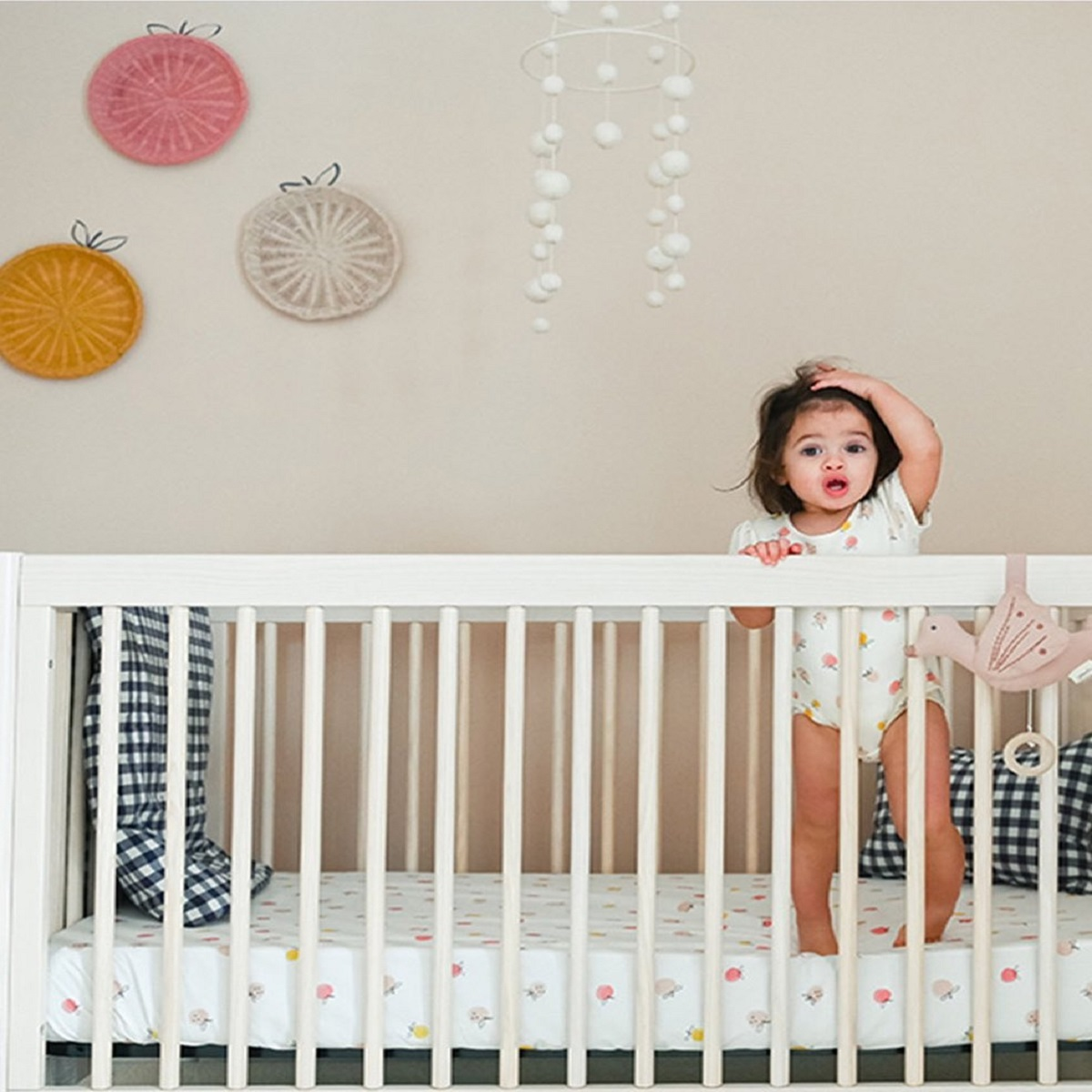 Little girl in crib