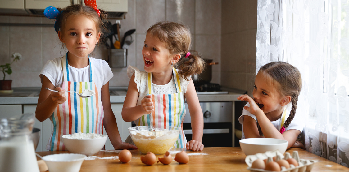 Happy kids cooking together during quarantine