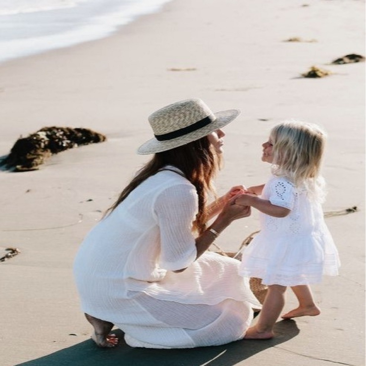 Mother and child on the beach wearing Doctor Rogers Restore Healing Balm