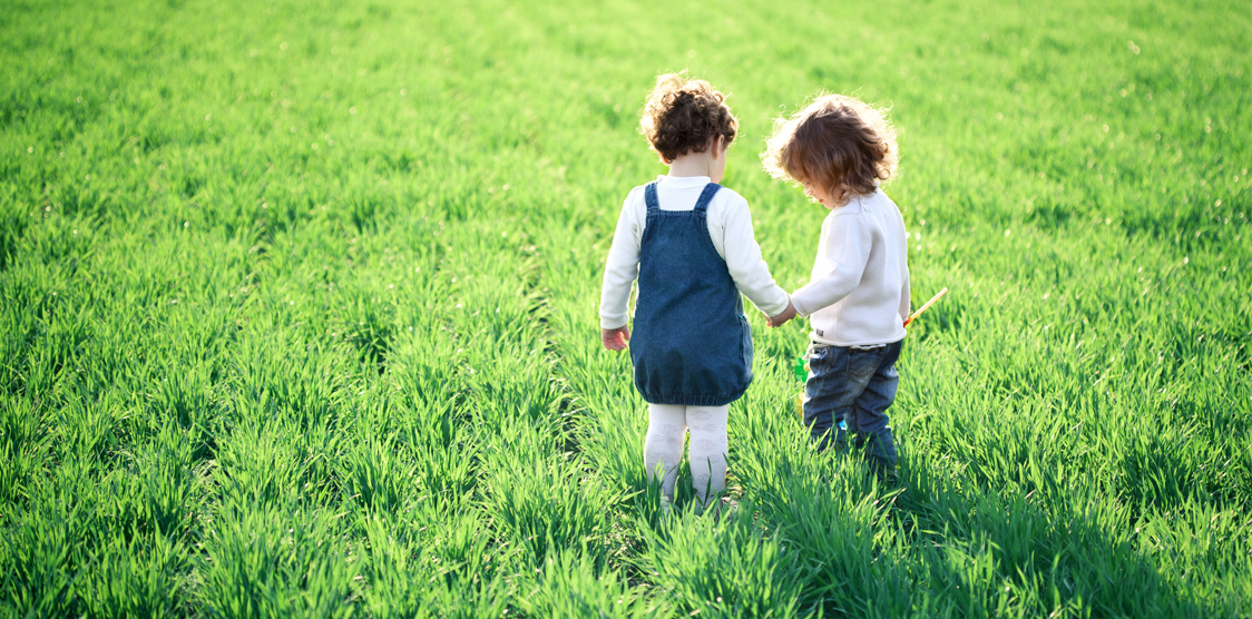 2 children in a field on Earth Day