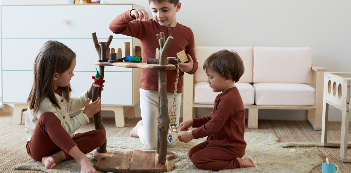 kids playing with wooden eco tree house