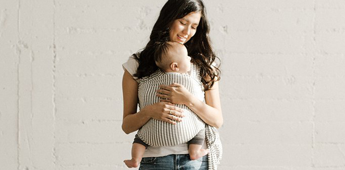 mom holding a baby in an organic sling