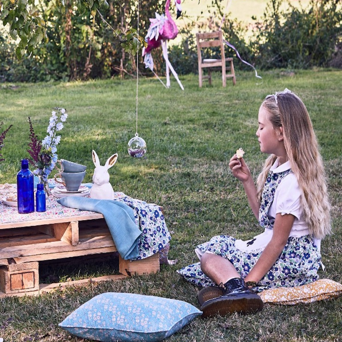 Young girl having a tea party outdoors