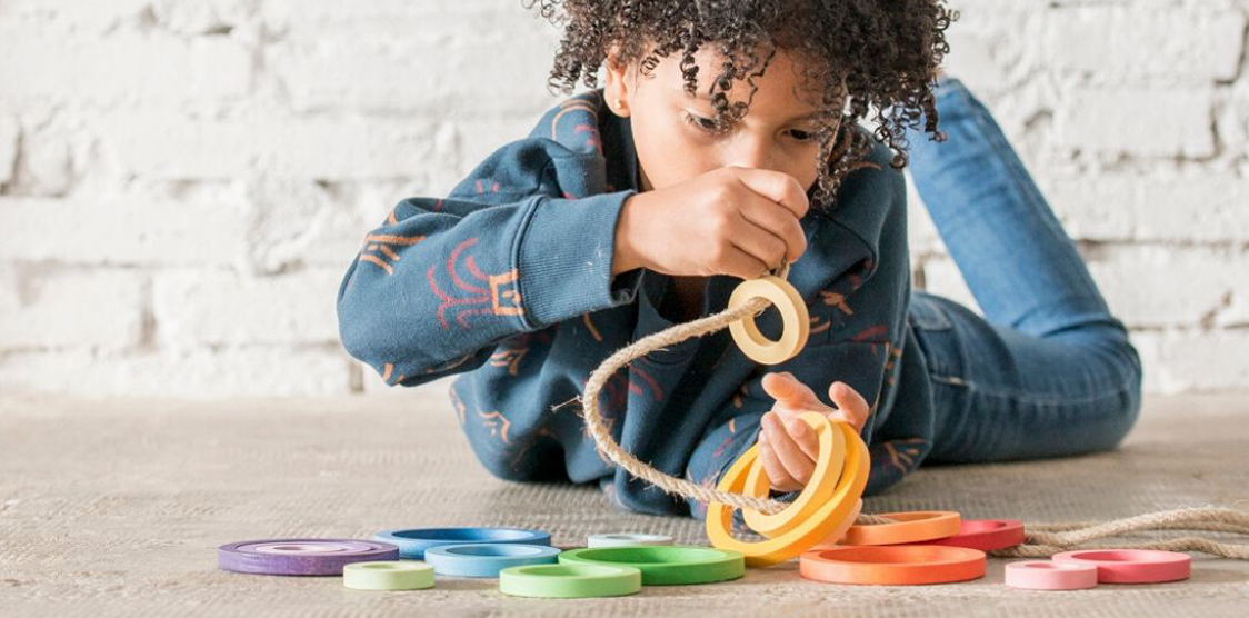 Child playing with open ended toys