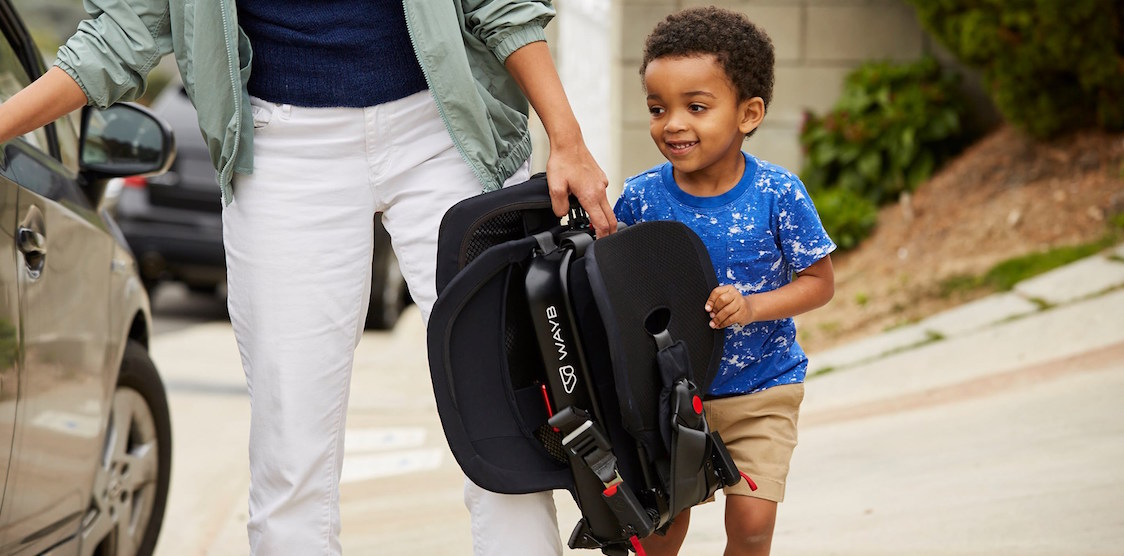 A little boy and his mother carrying the WAYB Pico Car Seat