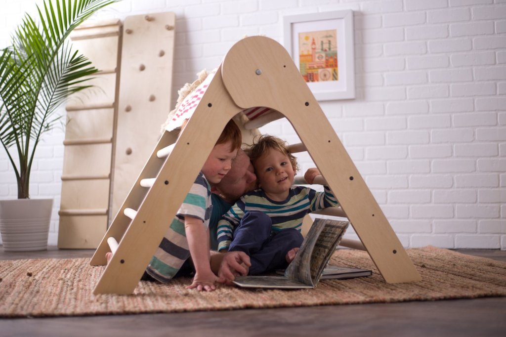 Two kids playing on the Sprout Triangular Climbing frame