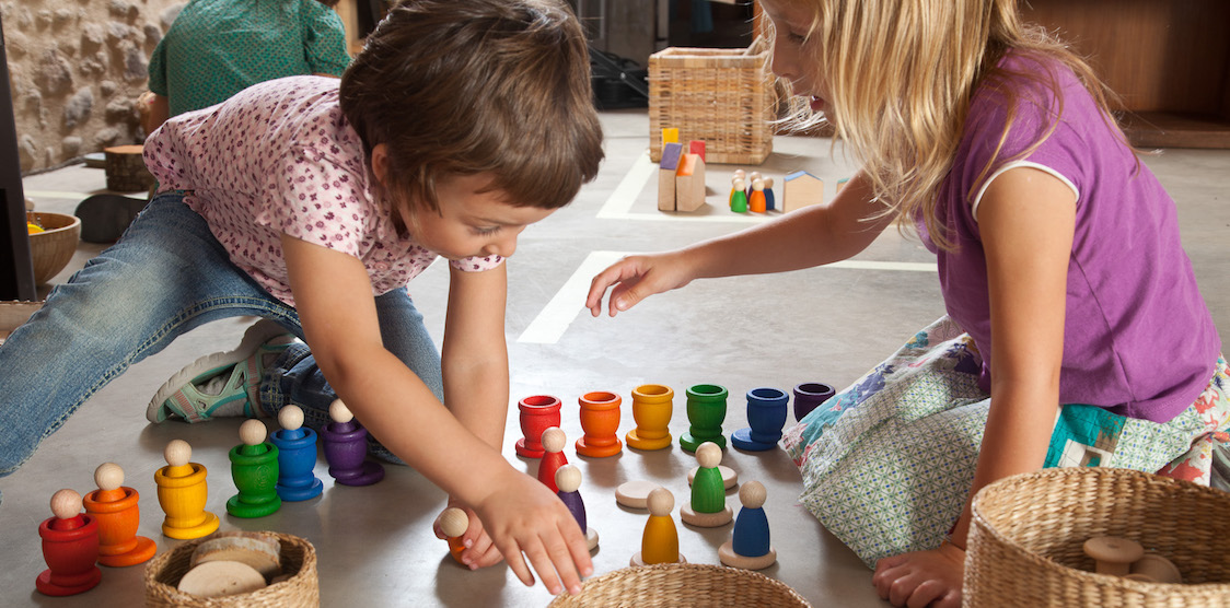 two children playing with colorful grapat toys