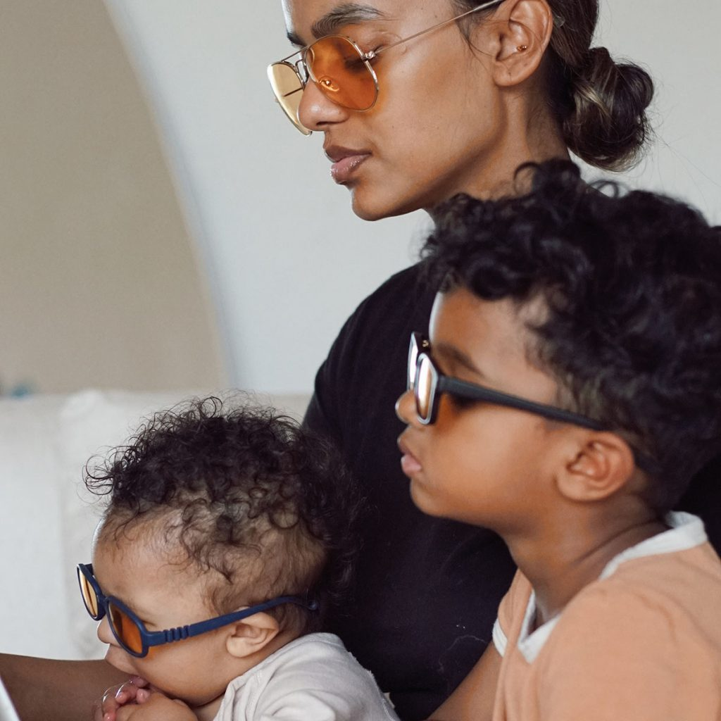 A mother and kids wearing RA Optics Blue Blocker Glasses