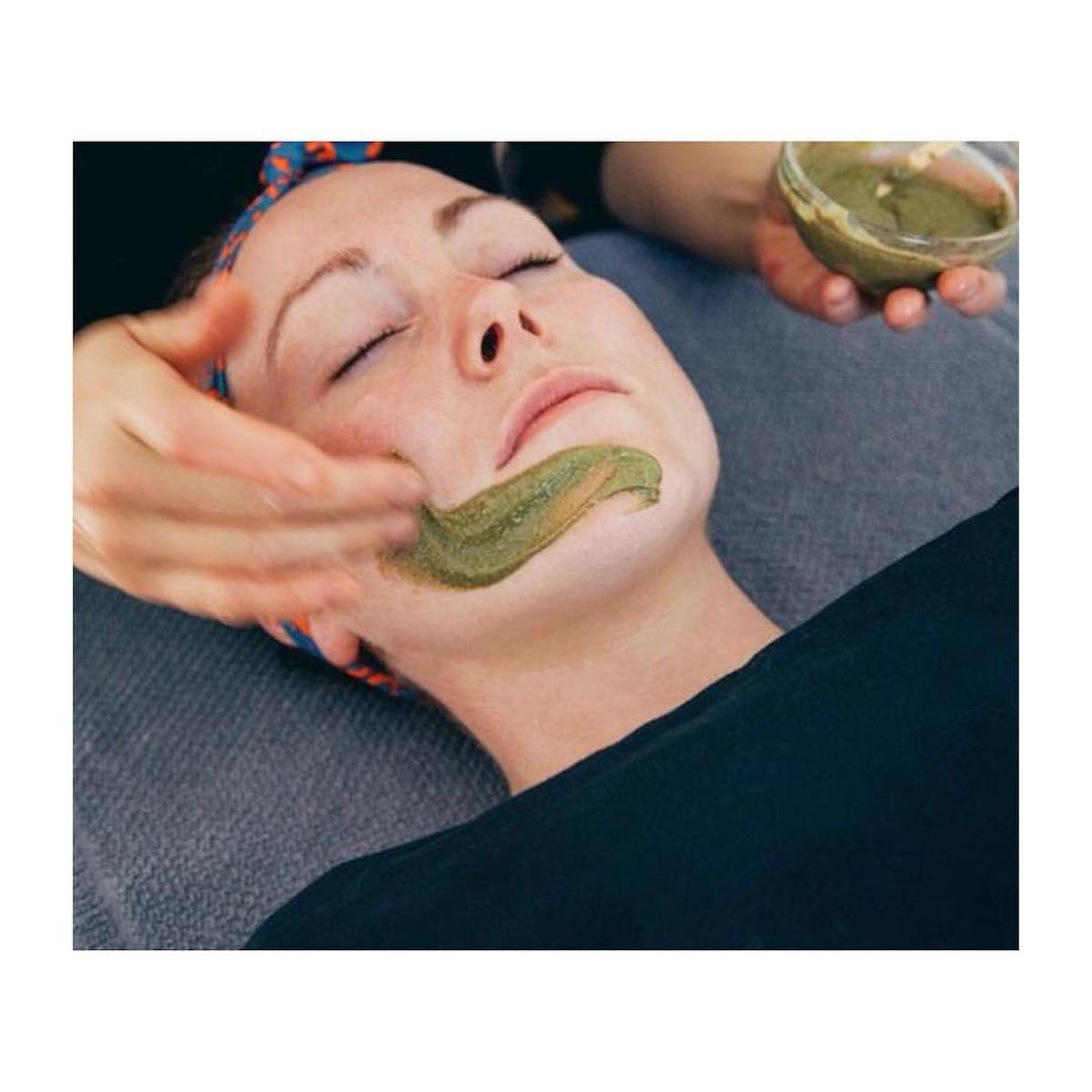 Woman getting a facial using Province Apothecary products