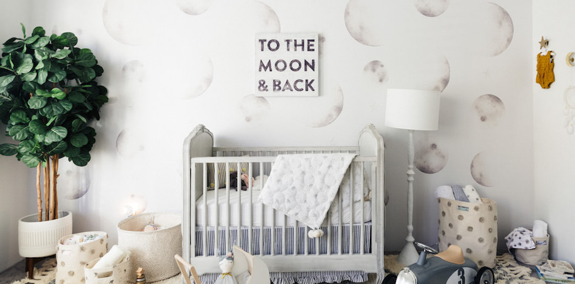 A nursery decorated with Anewall Luna Non-Toxic Wallpaper