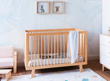 Stylish baby nursery with crib
