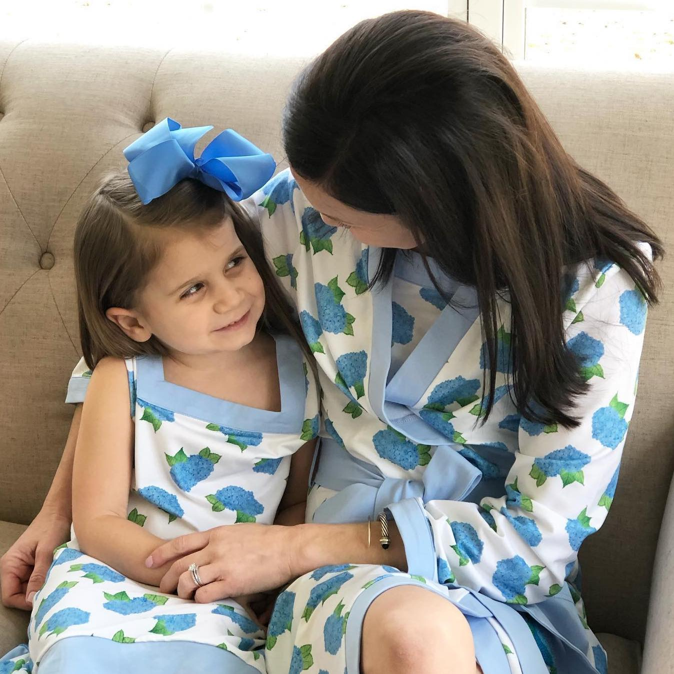 A mother and her daughter in matching Bella Bean Shop outfits