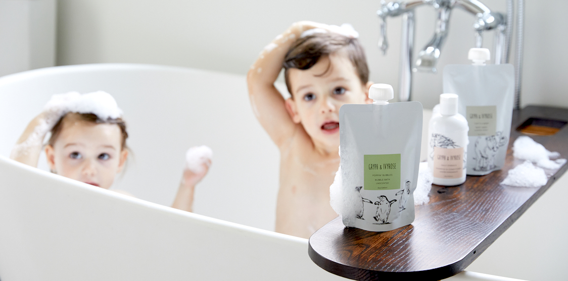 Two kids using non-toxic gryph & ivyrose bath products