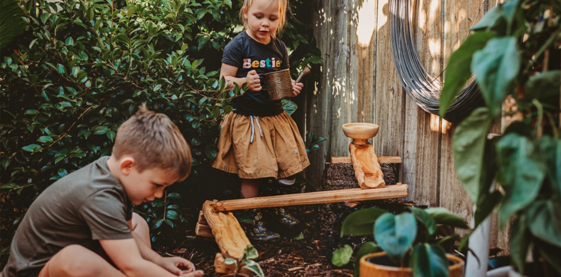kids playing with bamboo pipe toys