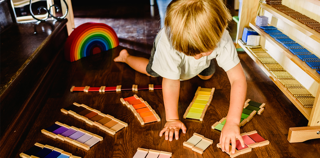 Child playing with montessori gradient colors