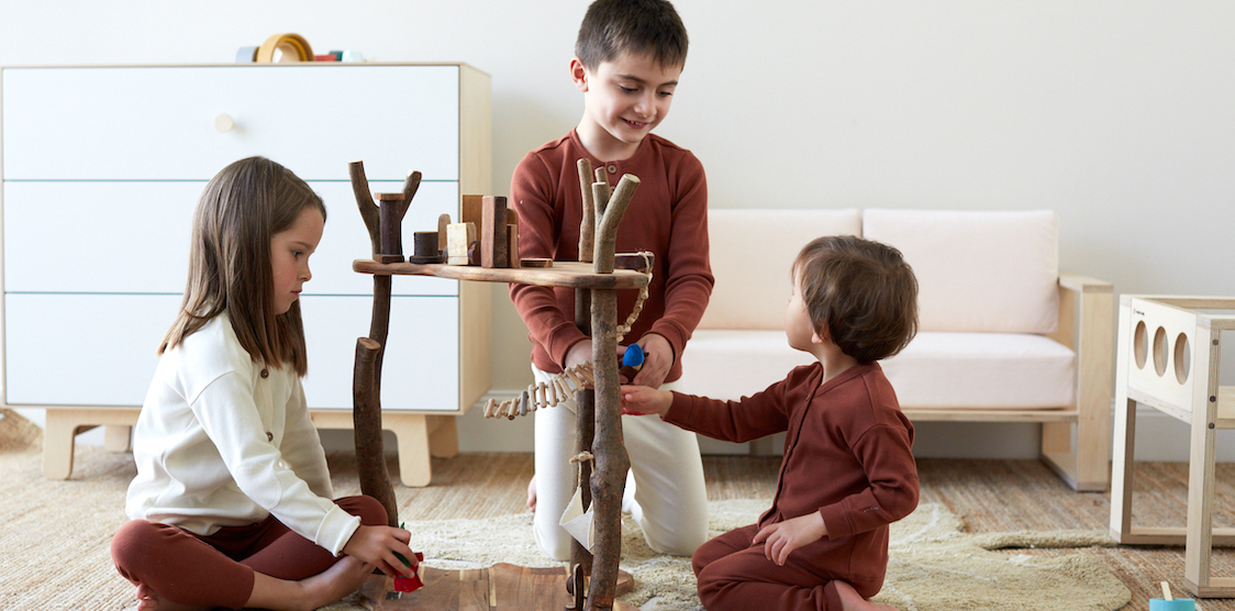 Three kids wearing HART + LAND Organic Cotton Rib basics while playing with the Q Toys Treehouse