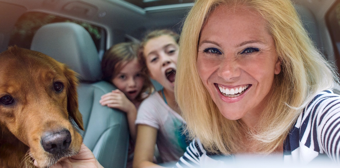 Photographer and author, Kate T Parker in the car with her dogs and two kids