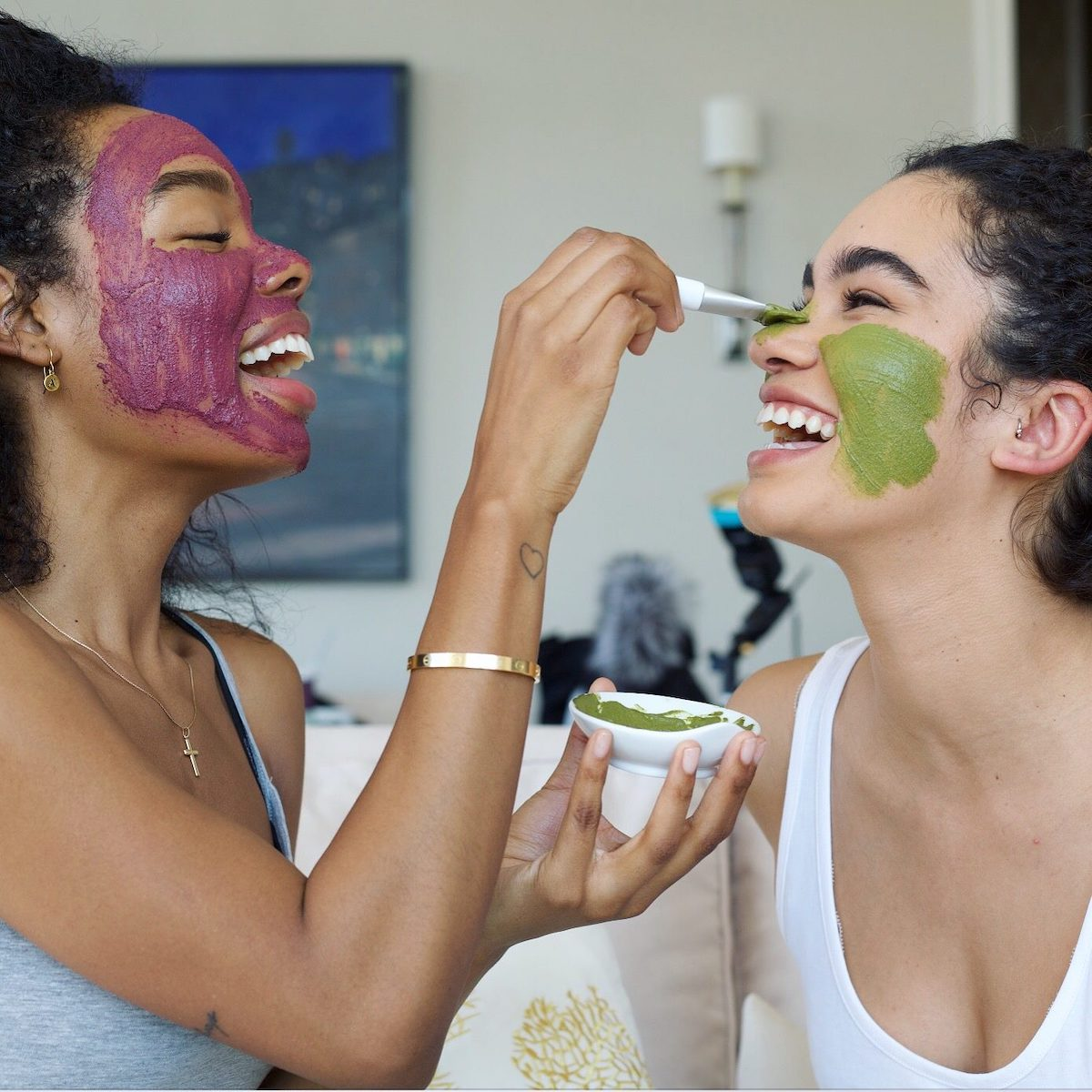 Two friends putting LOLI Beauty masks on each others' faces