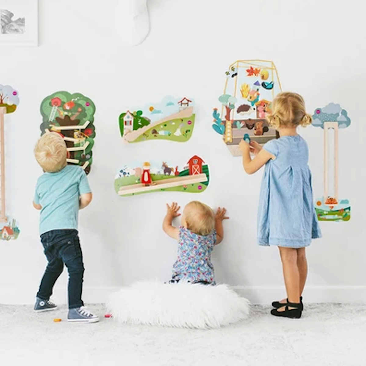 three children playing with Hollow Woodworks wall art