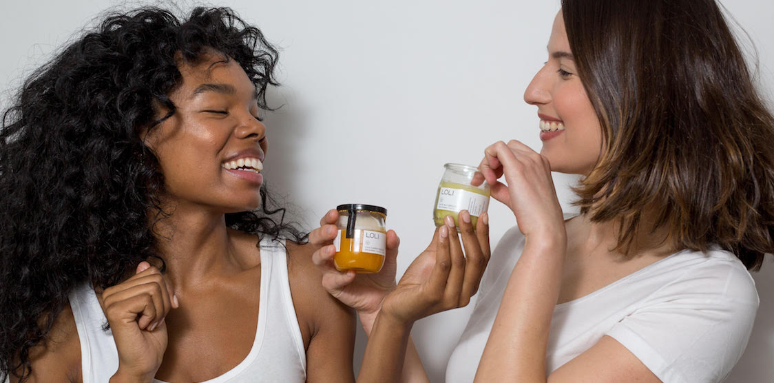 Two women using LOLI Beauty products