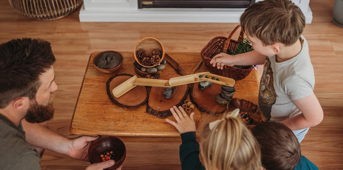 A family playing with the Explore Nook Mini Bamboo roll set