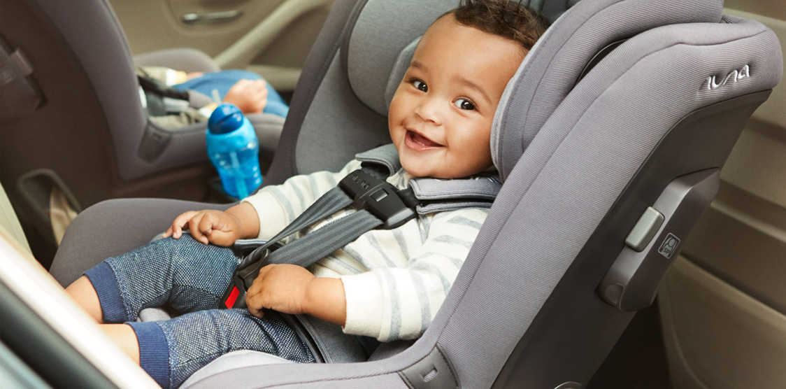 A baby strapped into a non-toxic car seat
