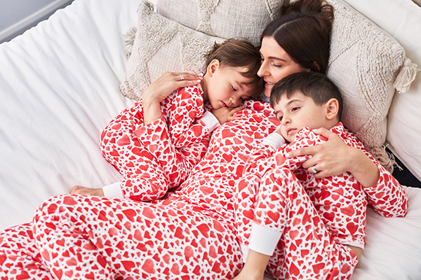 Family in matching valentines day pjs