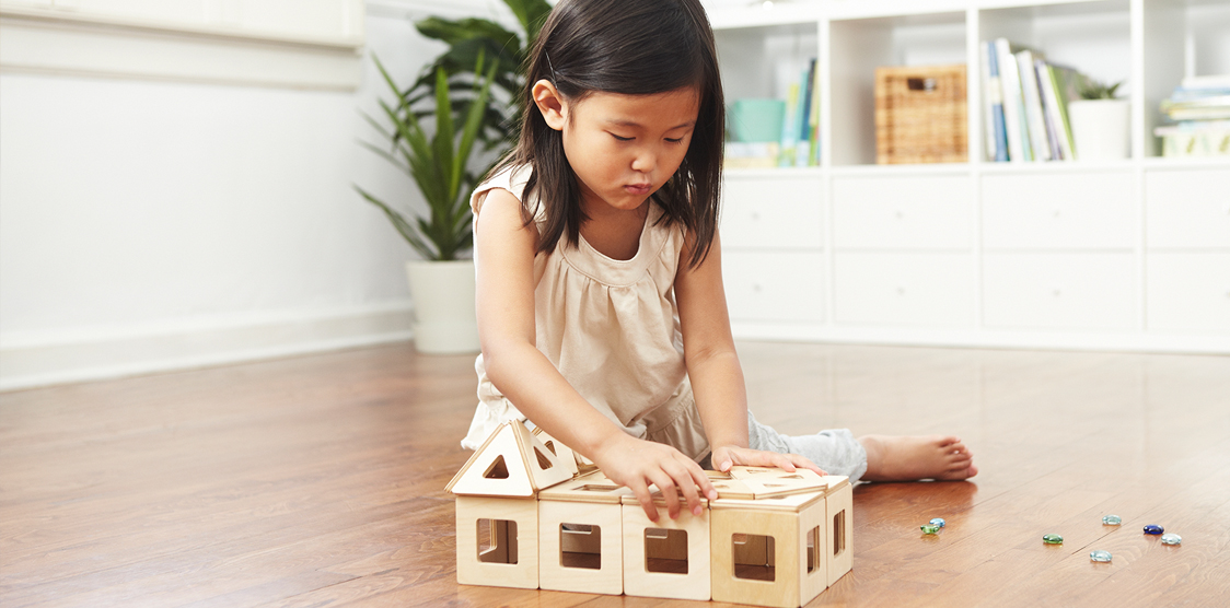 Child playing with wooden blocks during quiet time