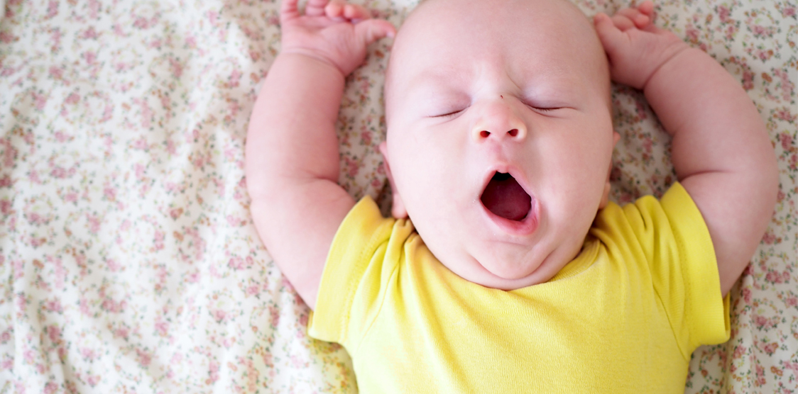 A tried baby yawning