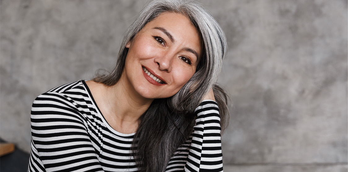 Young woman embracing her grey hair as a silver sister