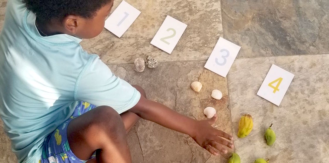 A child playing with nature during a homeschool lesson