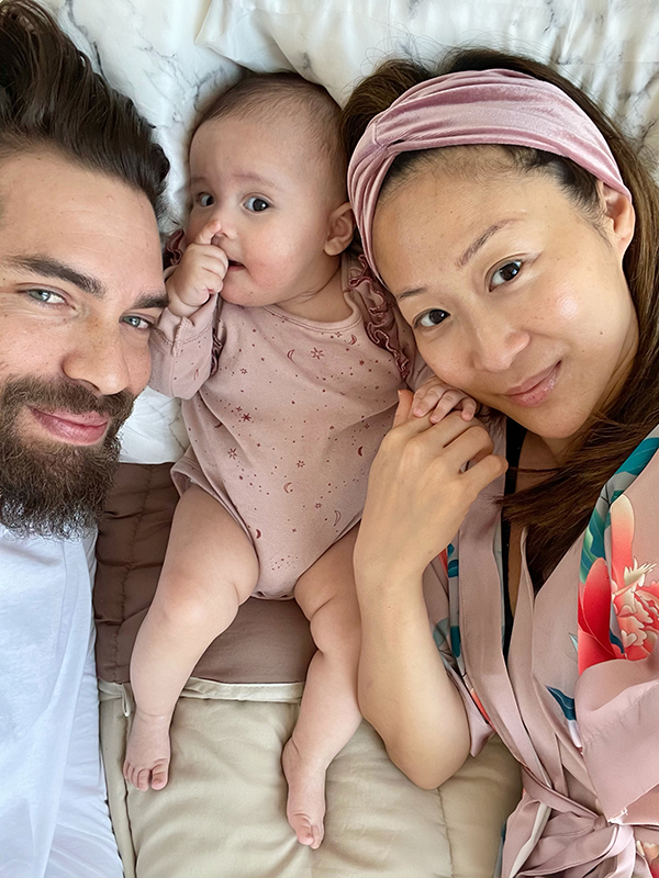 Christine Cho with baby and partner