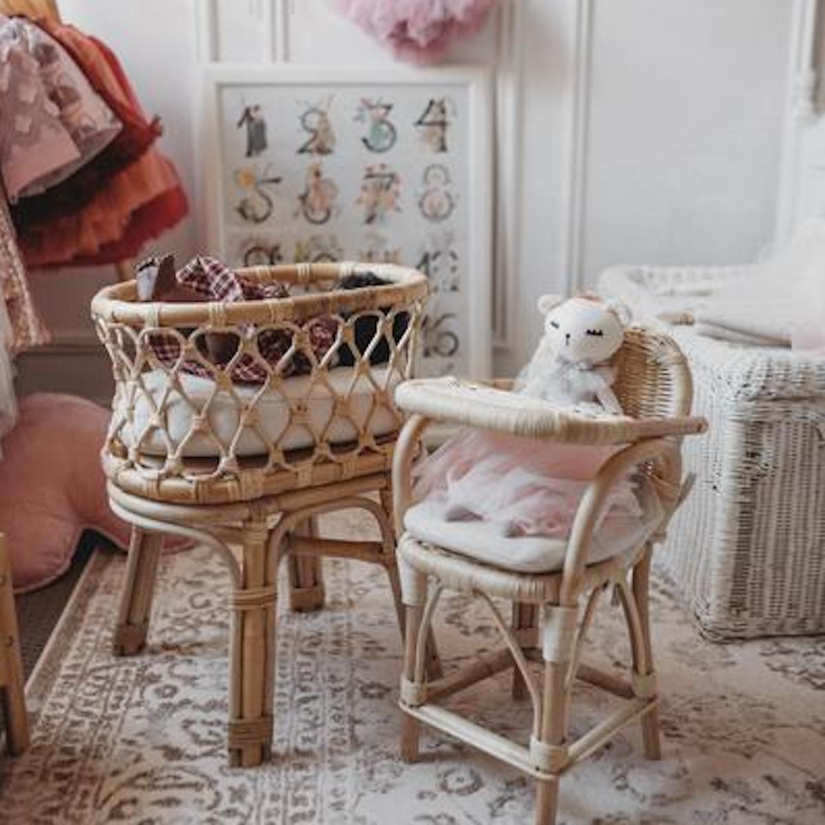 A child's bedroom with a Tiny Harlow doll's crib and high chair.